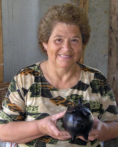 Lucia Valdez with piggy bank