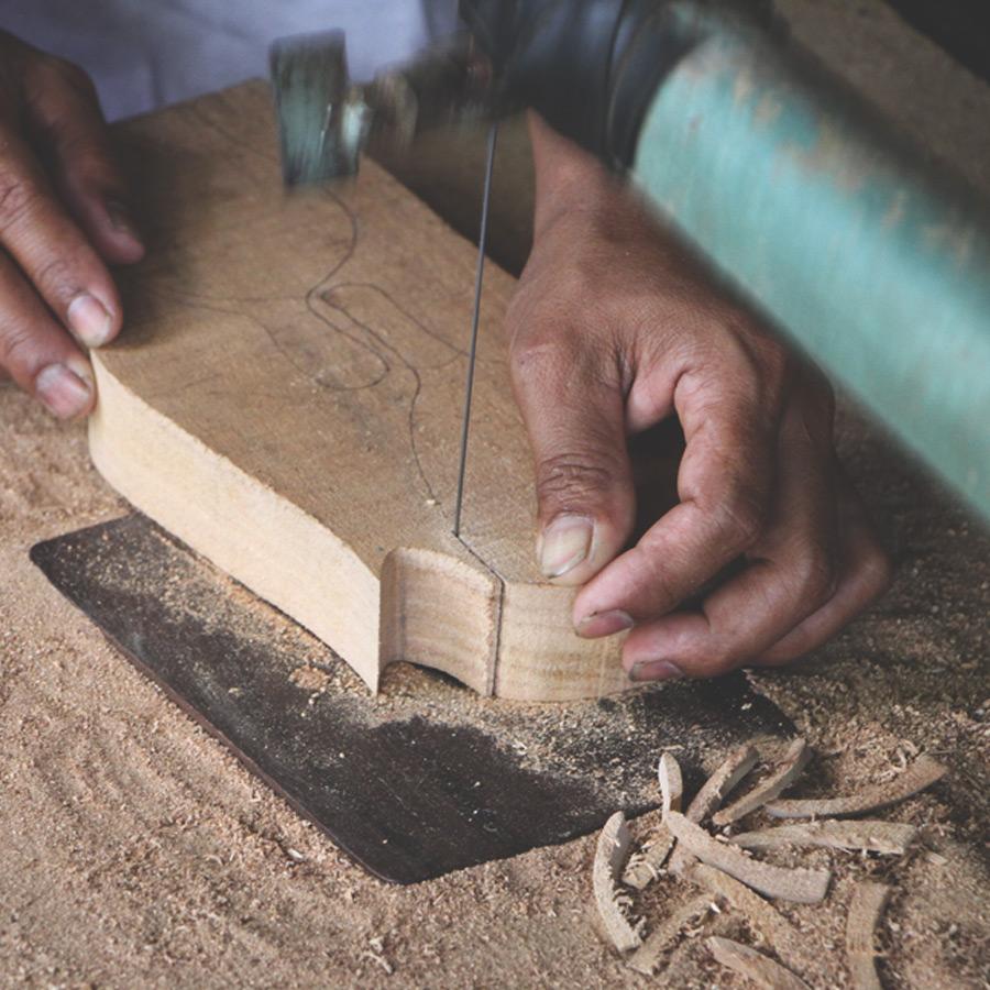 Craftsmanship. Wayan Diksa, wood craftsman, creates beautiful and practical woodwork from suar trees in Indonesia.