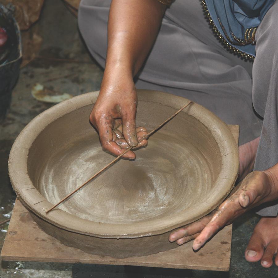 Craftsmanship. Inaq Aziz, clay craftsman, creates hand-thrown, hand-shaped pottery.
