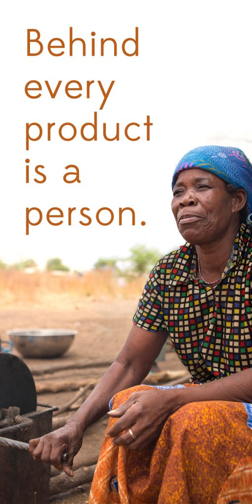 Behind every product is a person reads the text on a photo of an artisan in Ghana who is stoking a fire during shea butter production. | Celebrating 75 years of fair trade with Ten Thousand Villages.