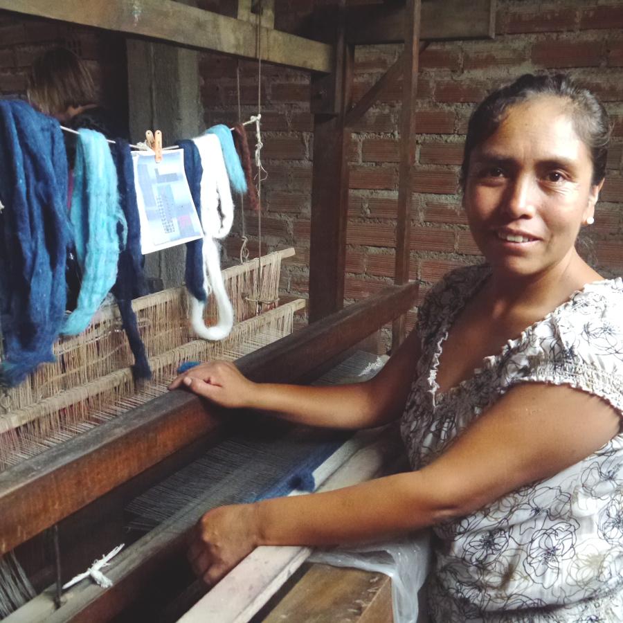 Craftsmanship. Herlinda Artola, textile craftsman, creates fair trade coiled wool wall hangings.
