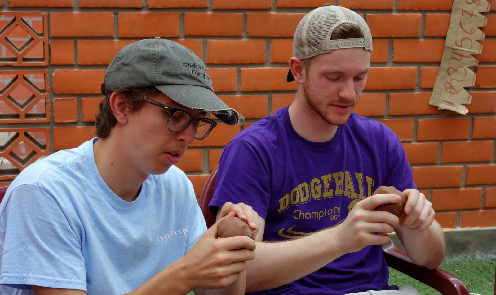 Goshen Student, Isaac Longenecker, pictured on the left, visits Manos Amigas in Peru.