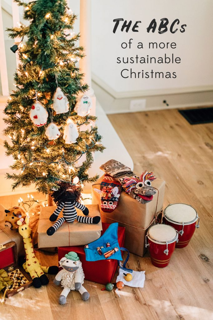 The ABCs of a more sustainable Christmas. Image shows a small lit-up tree with fair trade gifts, wrapped sustainably, below.