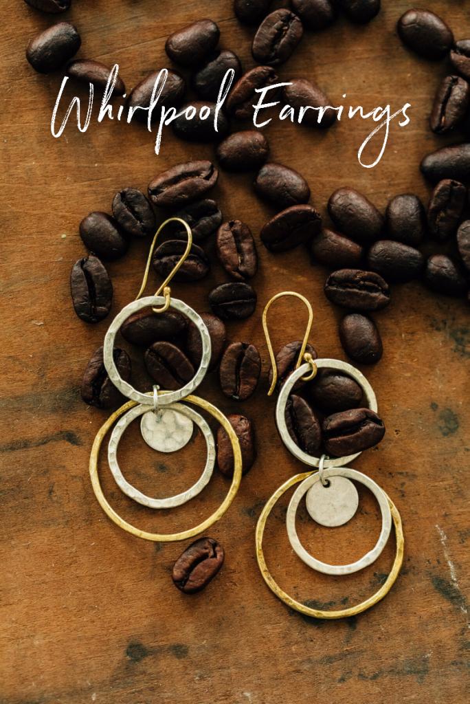 Whirlpool Earrings from Ten Thousand Villages   Handmade fair trade jewelry by artisans of Bombolulu Workshops in Kenya. Earrings lay in scattered coffee beans.